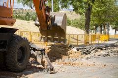 Excavator standing in sandpit Royalty Free Stock Images