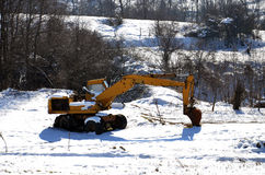 Excavator standing in a snow Royalty Free Stock Images