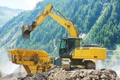 Excavator and stone crusher machine Stock Images