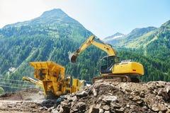Excavator and stone crusher machine Royalty Free Stock Photo