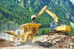 Excavator and stone crusher machine Stock Image