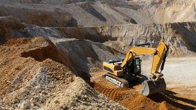 Excavator on the stone mine Royalty Free Stock Images
