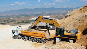 Excavator on the stone mine Stock Image