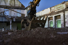 Excavator on stones at night, dark and blue stone Stock Images