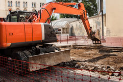 Excavator on the street constriction Stock Images