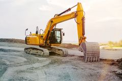 Excavator at street construction site on the countryside. Excavator at a street construction site on the countryside stock image