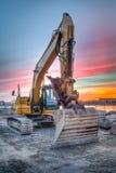 Excavator on sunset landscape Stock Images