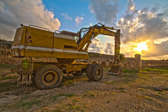 Excavator at sunset Stock Images