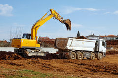 Excavator and tipper truck Stock Photography