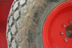 Excavator tire. Tire from a red excavator stock photo