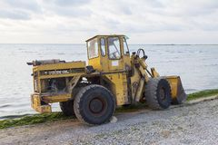 Excavator to clean algae on the beach Stock Photos