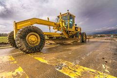 Free Excavator To Level And Smooth The Land In The Construction Of A Road Stock Photos - 160464643