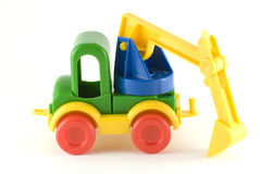 Excavator toy. It is an isolated plastic excavator toy on white background Stock Photos