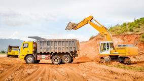 Excavator and truck in the road construction job, countryside of Myanmar Stock Photo