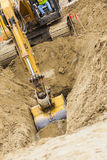 Excavator Tractor Digging A Trench Royalty Free Stock Photography