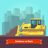 Excavator tractor levelling land Royalty Free Stock Image