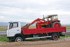 Excavator transported by a truck royalty free stock photography
