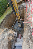 Excavator on trench - constructing canalization Royalty Free Stock Image