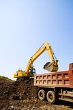 Excavator & truck royalty free stock photography