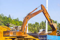 Excavator and truck body at location Royalty Free Stock Image
