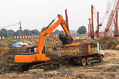Excavator and truck Stock Images