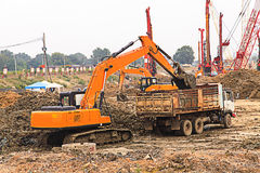 Excavator and truck Royalty Free Stock Photos