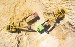 Excavator and truck in the mine. Stock Photography