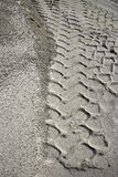 Excavator tyres footprint on quarry white sand Royalty Free Stock Image