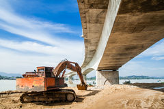 Excavator under a Bridge Royalty Free Stock Photos