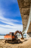 Excavator under a Bridge Stock Photography