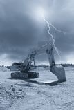 Excavator under stormy sky Royalty Free Stock Photos