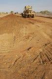 Excavator unloading sand Stock Images