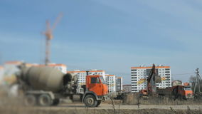 Excavator uploads a clay in a truck using a bucket. Excavator uploads a clay in a truck using a excavator bucket at construction site. Working process stock footage