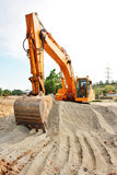 Excavator at work Stock Images