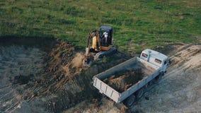 Excavator work from above. Excavator work from a bird`s eye view stock video footage