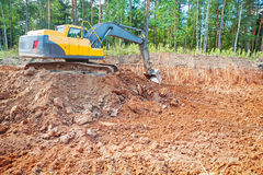 Excavator in work on constructon site in forest Royalty Free Stock Photo