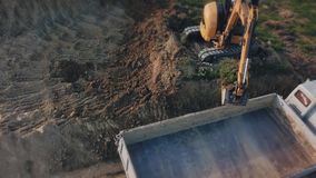Excavator work from height. Excavator work from a bird`s eye view stock video
