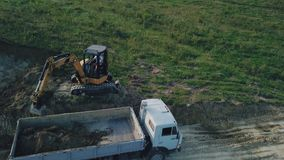 Excavator work from height. Excavator work from a bird`s eye view stock footage
