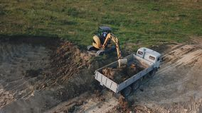 Excavator work from height. Excavator work from a bird`s eye view stock video footage