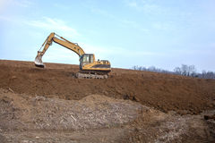 Excavator. On work of new vineyards in slovenia in vipava walley Royalty Free Stock Images