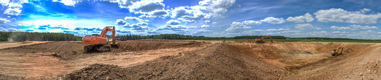 Free Excavator Work On The Pit Construction Of An Agricultural Complex In The Kaluga Region Of Russia. Stock Image - 125584061