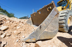 Excavator at work on site Royalty Free Stock Image