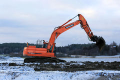 Excavator at Work in Winter Royalty Free Stock Images