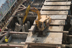 Excavator and Workers Royalty Free Stock Photography