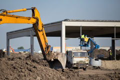 Excavator working at building site Royalty Free Stock Photography