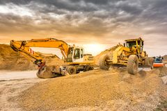 Excavator working on the construction of the extension works of the Madrid - Segovia - Valladolid highway Spain stock images