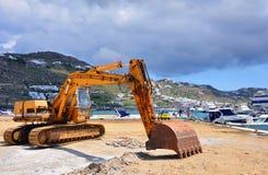 Excavator working on the construction Marine dock. Mekonos. Greece Royalty Free Stock Photography