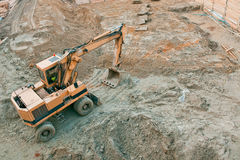Excavator working - construction site Royalty Free Stock Image