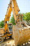 The excavator working. On a construction site Royalty Free Stock Photography