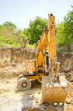 The excavator working. On a construction site Stock Images